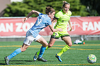 Seattle, WA - Sunday, April 17, 2016: Sky Blue FC defender Kelley O'Hara (19) drives past Seattle Reign FC defender Elli Reed (7) during the first half of the match. Sky Blue FC defeated the Seattle Reign FC 2-1 during a National Women's Soccer League (NWSL) match at Memorial Stadium.