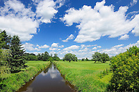 river and clouds<br /> Notre Dame de Stanbridge<br /> Quebec<br /> Canada