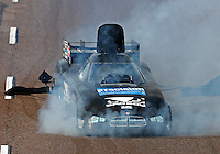 Feb 21, 2015; Chandler, AZ, USA; Smoke pours from beneath the car of NHRA funny car driver Shane Westerfield after suffering an engine fire during qualifying for the Carquest Nationals at Wild Horse Pass Motorsports Park. Mandatory Credit: Mark J. Rebilas-