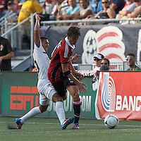 C.D. Olimpia substitute midfielder Irvin Reina (20) disrupts AC Milan substitute midfielder Bryan Cristante (54). In an international friendly, AC Milan defeated C.D. Olimpia, 3-1, at Gillette Stadium on August 4, 2012.