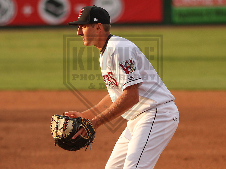 Wisconsin Timber Rattlers third baseman Dustin DeMuth (12) during a game against the Cedar Rapids Kernels on May 4th, 2015 at Fox Cities Stadium in Appleton, Wisconsin.  Cedar Rapids defeated Wisconsin 9-3.  (Brad Krause/Krause Sports Photography)