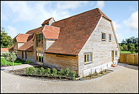 BNPS.co.uk (01202 558833)<br /> Pic: Strutt&amp;Parker/BNPS<br /> <br /> The dilapidated threshing barn in Greywell in Hampshire has been transformed into a open plan modern home.<br /> <br /> These stark before and after pictures show the remarkable transformation of a dilapidated barn into a luxurious home worth &pound;1.25million. <br /> <br /> The ramshackle 16th century structure on a derelict farm was in a state of near ruin before developer Mark Parmenter undertook the colossal project - his first ever barn conversion. <br /> <br /> Mr Parmenter, 60, identified the magnificent 400-year-old beams as the centrepiece of his project. <br /> <br /> Despite the decrepit exterior, which pictures show to have been rusty and crumbling, he was pleasantly surprised to find the inside in remarkably good condition. <br /> <br /> The property is now on the market with Strutt &amp; Parker.