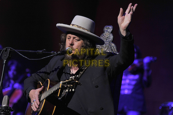 """Zucchero (Zucchero Fornaciari).World tour """"Chocabeck"""", Hall October, St.Petersburg, Russia..April 9th, 2012.on stage in concert live gig performance performing music half length black suit jacket hat white beard facial hair guitar singing arm in air.CAP/PER/VB.©VB/PersonaStars/CapitalPictures"""