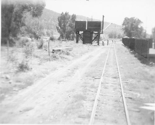RR track past reused tender water tank.<br /> D&amp;RGW  Arboles, CO