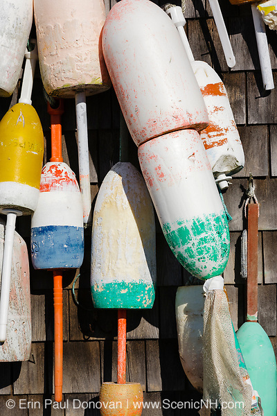 Buoys hang from a shed at The John Hancock Warehouse and Wharf located in York, Maine USA which is part of the New England seacoast.