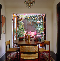 French windows open onto the garden in this compact dining room