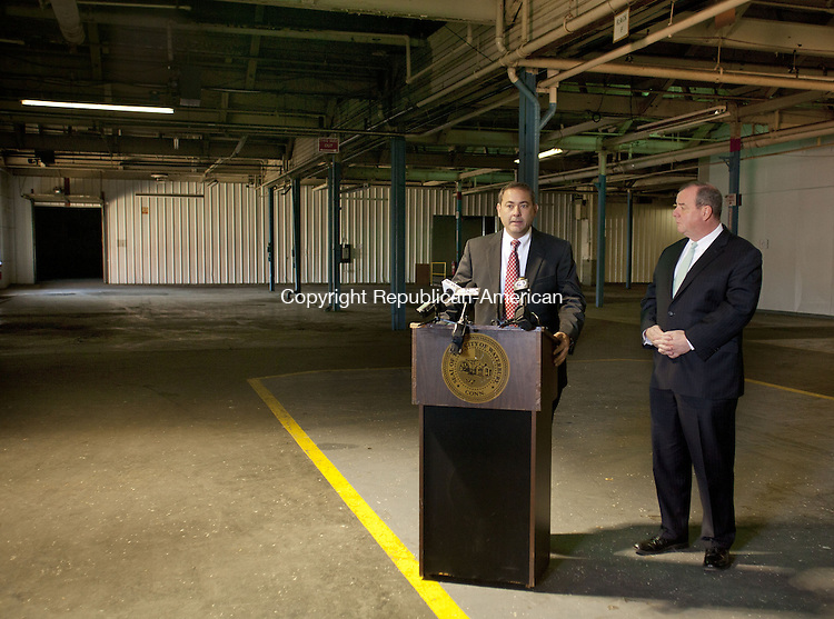 WATERBURY, CT-15 NOVEMBER 2013-111513BF01- Tom Macre Executive Director of C-Three, left, talks about the proposed medical marijuana company he hopes to bring to the city as Waterbury Mayor Neil M. O'Leary looks on during a press conference at the site Friday morning. The proposed 70,000 square-foot site on East Aurora Street in Waterbury  will house two separate companies at the site to grow and distribute medical marijuana. Bob Falcetti Republican-American