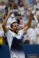 Marin Cilic of Croatia celebrates after beats Roger Federer of Switzerland during men semifinal match at the US Open 2014 tennis tournament in the USTA Billie Jean King National Center, New York.  09.05.2014. VIEWpress