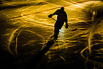 Stockholm 2014-03-21 Ishockey Kvalserien AIK - R&ouml;gle BK :  <br /> Siluett av ishockeyspelare p&aring; isen i ett nedsl&auml;ckt Hovet<br /> (Foto: Kenta J&ouml;nsson) Nyckelord:  portr&auml;tt portrait intro