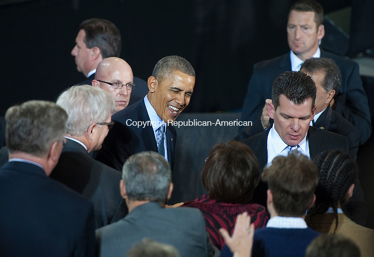 NEW BRITAIN, CT-030514JS02--President Barack Obama greets guests after speaking of the need to raise the minimum wage during visit to Connecticut State University in New Britain on Wednesday.  The President was  joined by Dannel P. Malloy  of Connecticut, Governor Deval Patrick of the Commonwealth of Massachusetts, Governor Lincoln D. Chafee of Rhode Island, Governor Peter Shumlin of Vermont and Secretary of Labor Thomas E. Perez.<br /> Jim Shannon Republican-American