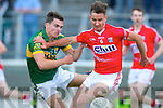 Ciaran Keating Kerry in a tussle for possession with Fionn O'Shea Cork at the Munster Junior Final at Austin Stack Park on Wednesday night.