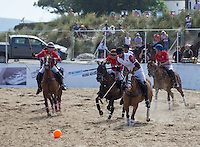 Tito Gaudenzi of England chases down the ball during the Wales v England match at the Asahi Beach Polo Championship  at Sandbanks, Poole, England on 10 July 2015. Photo by Andy Rowland.