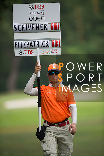 UBS staff Ross Chan displays a scoreboard during UBS Hong Kong Open golf tournament at the Fanling golf course on 25 October 2015 in Hong Kong, China. Photo by Aitor Alcade / Power Sport Images