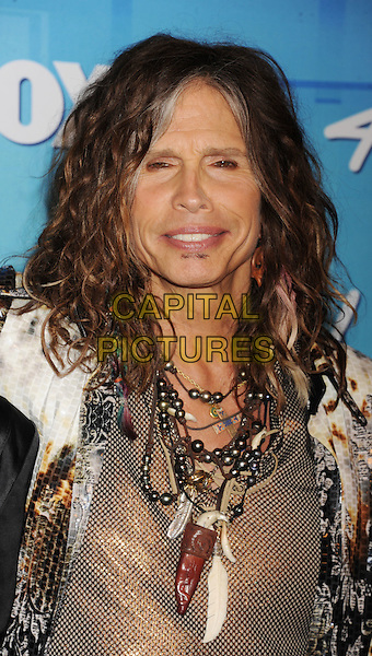 "Steven Tyler of Aerosmith.Press room during ""American Idol Season 11 Grand Finale"" Show at Nokia Theatre L.A. Live in Los Angeles, California, USA..May 23rd, 2012 .headshot portrait white gold necklaces.CAP/ROT/TM.©Tony Michaels/Roth Stock/Capital Pictures"