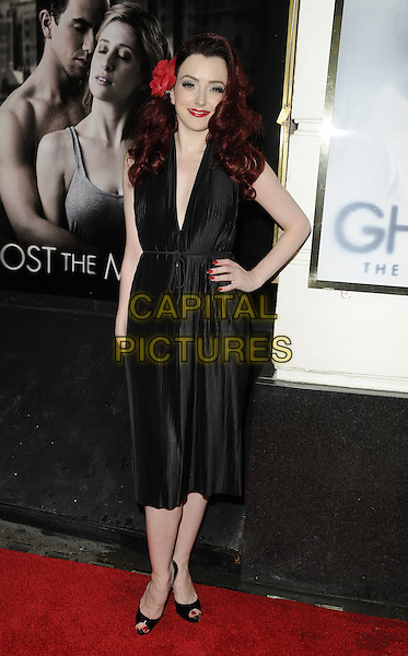 "Miss POLLY RAE.""Ghost The Musical"" press night, Piccadilly Theatre, Denman St., London, England..July 19th, 2011.full length black sleeveless dress hand on hip red flower in hair .CAP/CAN.©Can Nguyen/Capital Pictures."