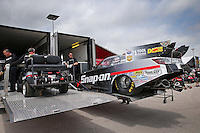 Apr. 26, 2013; Baytown, TX, USA: NHRA crew members for funny car driver Cruz Pedregon during qualifying for the Spring Nationals at Royal Purple Raceway. Mandatory Credit: Mark J. Rebilas-