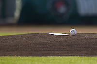 Baseball rests at the mound on May 23, 2016 at Parkview Field in Fort Wayne, Indiana. (Andrew Woolley/Four Seam Images)