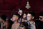 A unicorn head appears above the crowd as a they await electronic musician Cashmere Cat performs on stage at Weekend 1 of the Coachella Valley Music and Arts Festival in Indio, California April 11, 2015. (Photo by Kendrick Brinson)