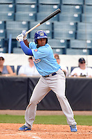 Daytona Cubs third baseman Jeimer Candelario (12) at bat during a game against the Tampa Yankees  on April 13, 2014 at George M. Steinbrenner Field in Tampa, Florida.  Tampa defeated Daytona 7-3.  (Mike Janes/Four Seam Images)
