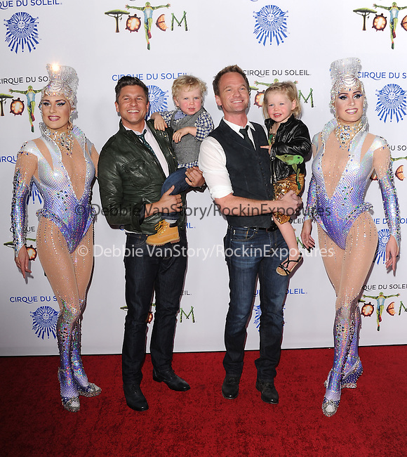 Neil Patrick Harris and husband David Burtka with their kids attends Totem from Cirque du Soleil Premiere at Santa Monica Pier in Santa Monica, California on January 21,2014                                                                               © 2014 Hollywood Press Agency