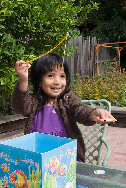 erkeley CA Girl, four,  adopted Guatemalan, playing fishing game, proud of catch  MR