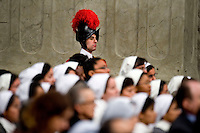 Citta del Vaticano, 12 Dicembre, 2014. Una Guardia Svizzera durante la celebrazione di una messa nella Basilica di San Pietro. <br /> A Swiss Guard attends the mass of Pope Francis on the occasion of the feast of Our Lady of Guadalupe in St. Peter's Basilica at the Vatican.