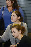 Amanda Knox is comforted by her sister Deanna Knox, right, during her press conference after her arrival in the United States at Seattle-Tacoma International Airport in Seattle Tuesday, October 4. Knox's murder conviction was overturned by an Italian appellate court after spending four years in prison in Italy. Photo by Daniel Berman/www.bermanphotos.com
