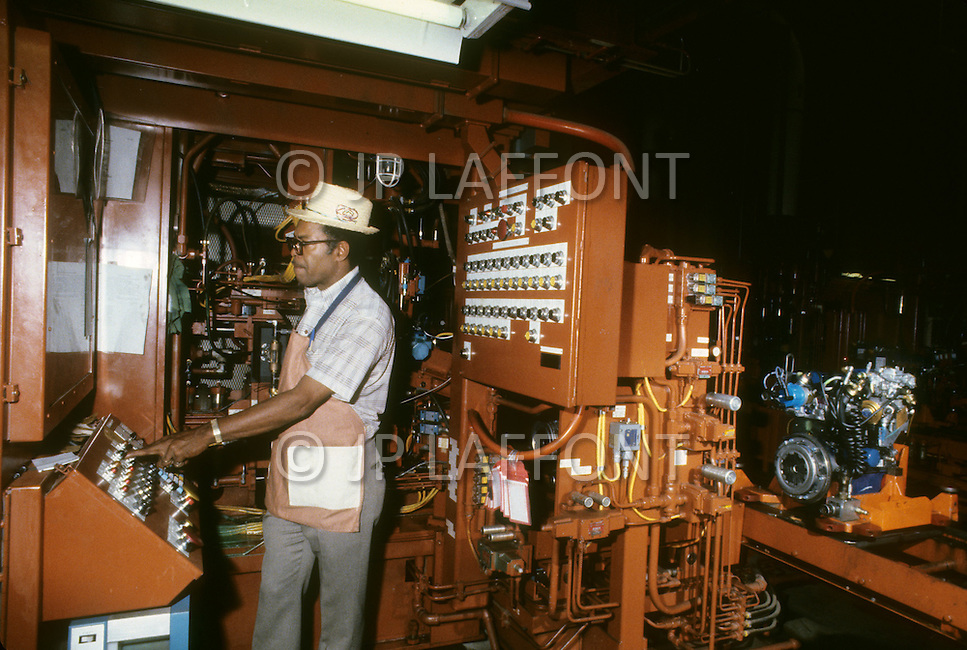 Detroit, U.S.A, December, 1980. Robot control on the assembly line inside the Ford Rouge Factory.