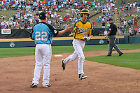 WILLIAMSPORT, PA - AUGUST 25. Ryan Lyle #22 of the South East team from Goodlettsville, Tennessee congratulates Kempton Brandis #15 of the West team from Petaluma, California after hitting a home run during the United States Championship game of the Little League World Series at Lamade Stadium on Saturday, August 25, 2012 in Williamsport, PA. (Photo by Hunter Martin/MLB Photos via Getty Images) ***Local Caption*** Ryan Lyle;Kempton Brandis