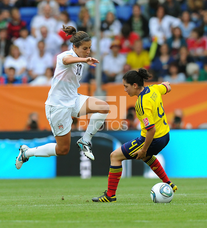 Carli Lloyd (r) of team USA and Diana Ospina of team Columbia during the FIFA Women's World Cup at the FIFA Stadium in Sinsheim, Germany on July 2nd, 2011.