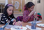 Woodbury, CT 122216MK02  Sisters Francesa and Isobel Rivera paint their decorations at the Woodbury Library on Thursday night. Kate Gorham of the Golden Button Craft Studio assisted the children in making vintage tin ornaments. Marla Martin, teen liberian, said that monthly events are held for a wide range of age groupings and interests.  Information on the upcoming events can be found on their website. Michael Kabelka / Republican-American