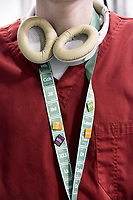 A worker wears a Leafly lanyard that displays different strains of cannabis in the style of chemicals on the periodic table in a grow room at the production and packaging facility for Garden Remedies, a medical cannabis producer, in Fitchburg, Massachusetts, USA, on Fri., Feb. 22, 2019. Leafly is an online service and app used for finding information about cannabis strains available and dispensaries near the user.