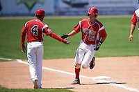 Batavia Muckdogs catcher Blake Anderson (26) high fives manager Angel Espada (4) after hitting a home run during a game against the Williamsport Crosscutters on July 16, 2015 at Dwyer Stadium in Batavia, New York.  Batavia defeated Williamsport 4-2.  (Mike Janes/Four Seam Images)