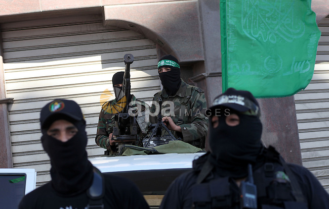 "Palestinian members of the al-Qassam brigades, the armed wing of the Hamas movement, standing guard as they wait for the arrival of Hamas chief Khaled Meshaal in Gaza city December 7, 2012. Hamas's exiled leader Meshaal will step onto Palestinian land for the first time in 45 years on Friday for a ""victory rally"" in the Gaza Strip, displaying his newfound confidence after last month's conflict with Israel. Meshaal, the Islamist group's leader, who has not visited the Palestinian Territories since leaving the West Bank at age 11, emerged emboldened from the eight-day conflict which ended in a truce he negotiated under Egypt's auspices. He has since spoken of reaching out to other Palestinian factions. Photo by Ashraf Amra"