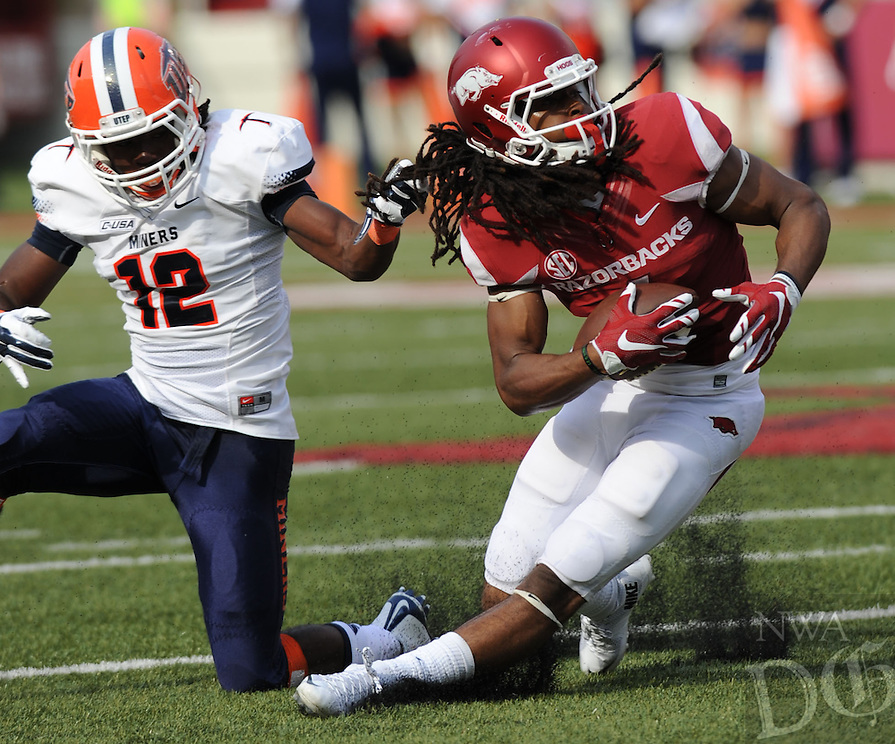 NWA Democrat-Gazette/ANDY SHUPE<br /> Arkansas' Keon Hatcher (right) is brought down by his hair by University of Texas at El Paso's Adrian Hynson Saturday, Sept. 5, 2015, during the fourth quarter of play in Razorback Stadium in Fayetteville. Visit nwadg.com/photos to see more from the game.