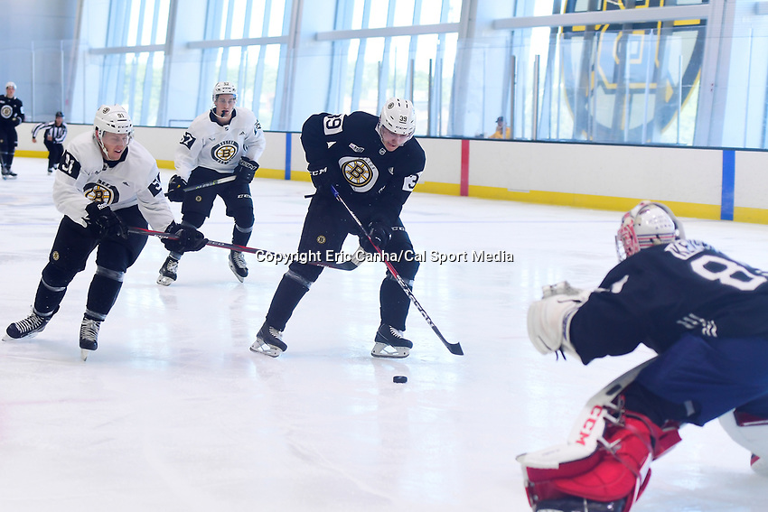 June 29, 2018: Boston Bruins forward Colin Theisen (91) tries to check the shot of forward Jakub Lauko  during a scrimmage at the Boston Bruins development camp held at Warrior Ice Arena in Brighton Mass. Eric Canha/CSM