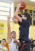 Michael Gannon #34 of Smithtown West, right, shoots a jumper as Evan Lapidus #13 of Jericho guards him during a non-league game in Richard Brown Nassau-Suffolk Challenge at Uniondale High School on Saturday, Jan. 14, 2017. Smithtown West won by a score of 56-45.