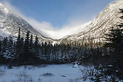 Mount Washington, Tuckerman Ravine in the White Mountains, New Hampshire in extreme weather conditions during the winter months. Strong winds cause snow to blow across the mountain tops.
