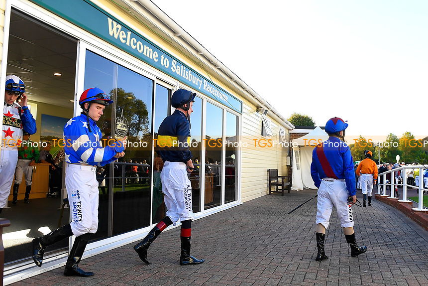 Jockeys exit the weighing room during Afternoon Racing at Salisbury Racecourse on 3rd October 2018