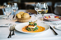 Dentice Rosso - red snapper, ancient grains, english peas, baby artichokes, hazelnut romesco at Barolo Grill Ryan Fletter in Denver, Colorado, Wednesday, May 23, 2018. Barolo Grill was awarded the Grand Award for 2018 by Wine Spectator Magazine.<br /> <br /> Photo by Matt Nager
