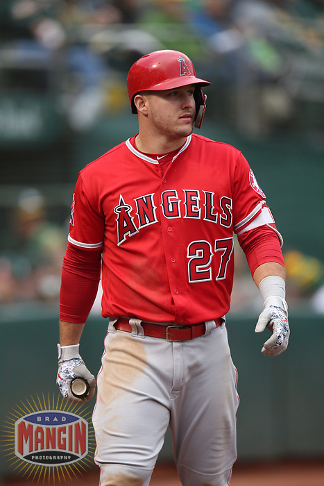 OAKLAND, CA - JUNE 15:  Mike Trout #27 of the Los Angeles Angels of Anaheim walks to the dugout from the on deck circle against the Oakland Athletics during the game at the Oakland Coliseum on Friday, June 15, 2018 in Oakland, California. (Photo by Brad Mangin)