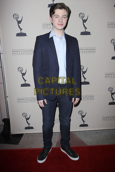 CHRIS COLFER .An evening with 'GLEE' held At Leonard H. Goldenson, North Hollywood, California, USA, 26th April 2010..full length jeans black trainers jacket blazer shirt navy blue.CAP/ADM/KB.©Kevan Brooks/AdMedia/Capital Pictures.