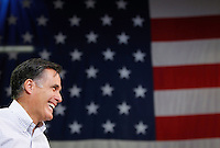 Mitt Romney smiles during a town hall meeting to discuss jobs and the economy at Diamond V, an animal nutrition company in Cedar Rapids, Iowa on Friday, December 9, 2011.   (Christopher Gannon/MCT)