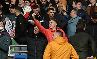 Swansea City fans taunt the Cardiff City supporters <br /> <br /> Photographer Ian Cook/CameraSport<br /> <br /> The EFL Sky Bet Championship - Cardiff City v Swansea City - Sunday 12th January 2020 - Cardiff City Stadium - Cardiff<br /> <br /> World Copyright © 2020 CameraSport. All rights reserved. 43 Linden Ave. Countesthorpe. Leicester. England. LE8 5PG - Tel: +44 (0) 116 277 4147 - admin@camerasport.com - www.camerasport.com