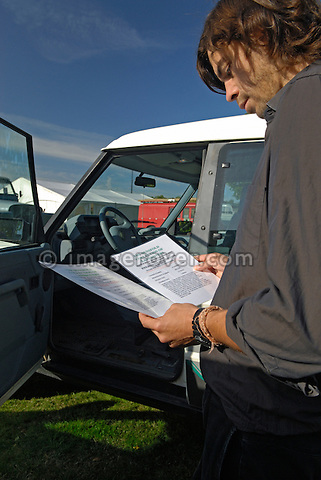 Visitor Jochen Buettner studying the vehicle history of an early Land Rover Discovery 1 at the at the Dunsfold Collection of Land Rovers 2006 open day, Dunsfold, Surrey, England, UK.  --- No releases available. Automotive trademarks are the property of the trademark holder, authorization may be needed for some uses.