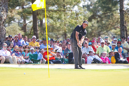 10.04.2014. Augusta, Georgia, USA.  Phil Mickelson chips to the pin on the 7th green, but the ball rolls past the hole and off the green during the first round of the Masters Tournament, Thursday, April 10, 2014, in Augusta, Ga