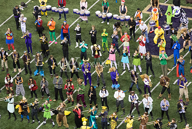 The Husky Band is decked out in full Halloween regalia during a victorious postgame show.