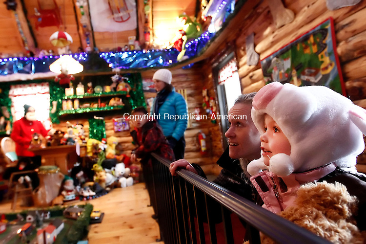 Torrington, CT- 08 December 2013-120813CM11-  Makenzie Doherty, 4, and her mom Jodi Kennedy, of Bristol enjoy the sights and sounds of the toy shop during the annual Carol Bozenski Christmas Village in Torrington Sunday. The Christmas Village will be open through December 23, from  1 p.m. to 8:30 p.m.  The hours closing day, Christmas Eve will be open from 9 a.m. until 12 p.m. Christopher Massa Republican-American