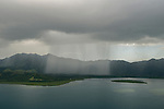 Aerial - rain falling on the mainland near Nukubati Island.