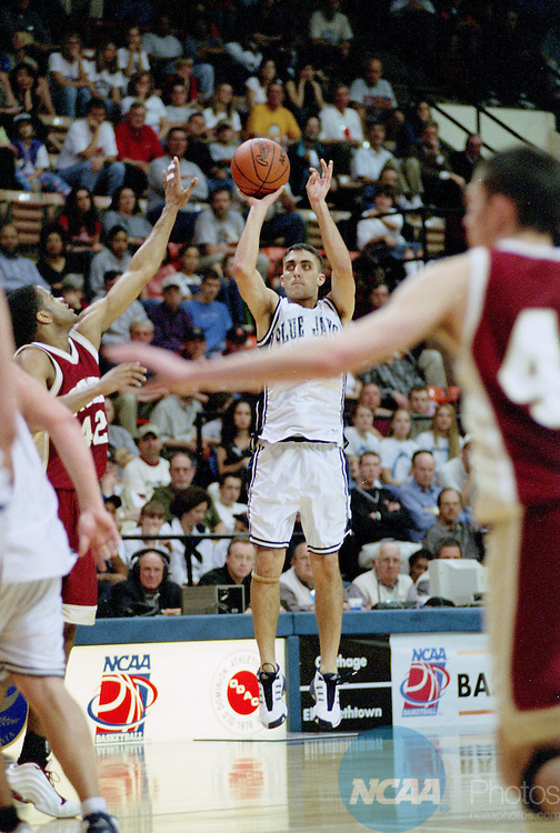 16 MAR 2002:  Guard Brian Marquette (24) of Elizabethtown College puts up a shot over forward Robert Mock (42) of Otterbein College during the Division 3 Men's Basketball Championship held at the Salem Civic Center in Salem, VA.  Otterbein defeated Elizabethtown 102-83 for the national title.  Andres Alonso/NCAA Photos